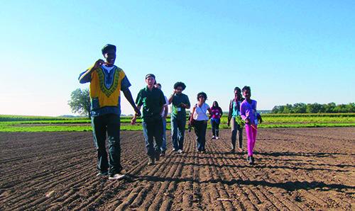 Youth walking in a unplanted field
